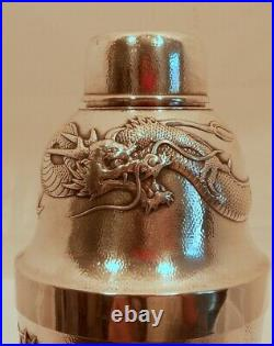 A Chinese Export sterling cocktail shaker, repousse dragons, sun, signed