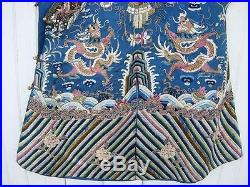 An Antique Chinese Embroidered Blue Silk Dragon Robe