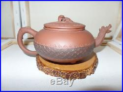 Antique Chinese Yixing zisha clay teapot with dragon motif