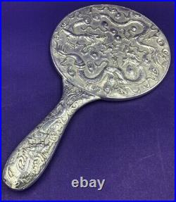 Chinese export dragon decorated silver ladies hand mirror Circa 1900