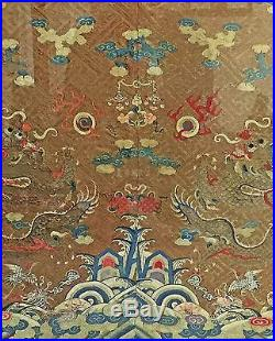 LARGE ANTIQUE CHINESE FRAMED TEXTILE WITH DRAGONS MING